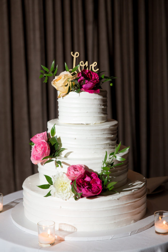 buttercream cake with fuschia and pink florals statuesque events