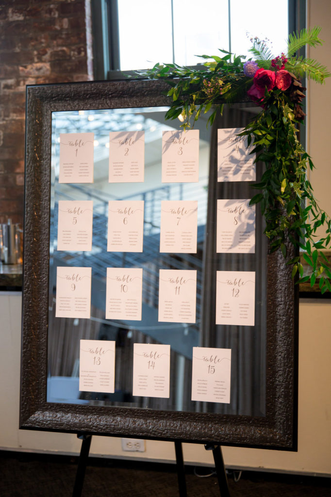 mirror seating chart with greenery decor new york wedding planner statuesque events