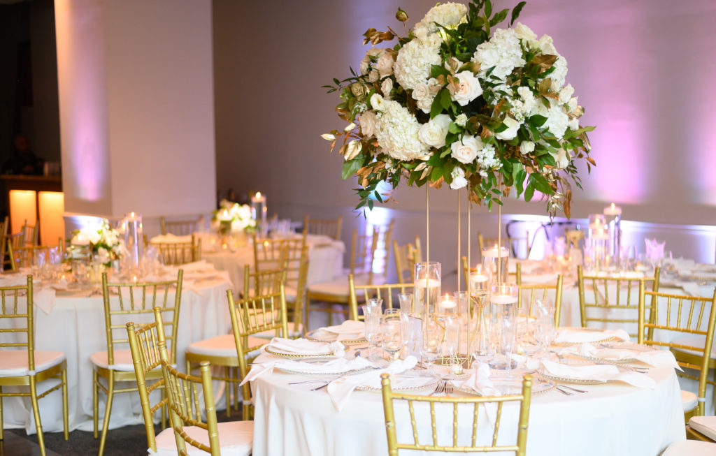 greenery centerpieces on gold stands maryland wedding planner statuesque events