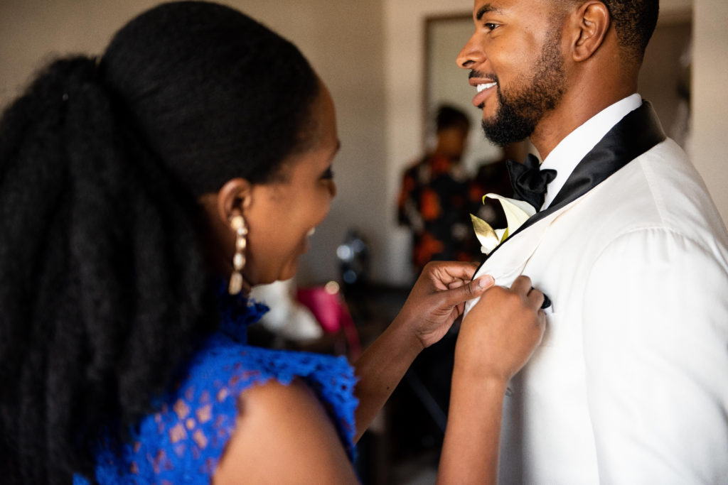 how to pin a boutoniere on a groom maryland wedding planner statuesque events