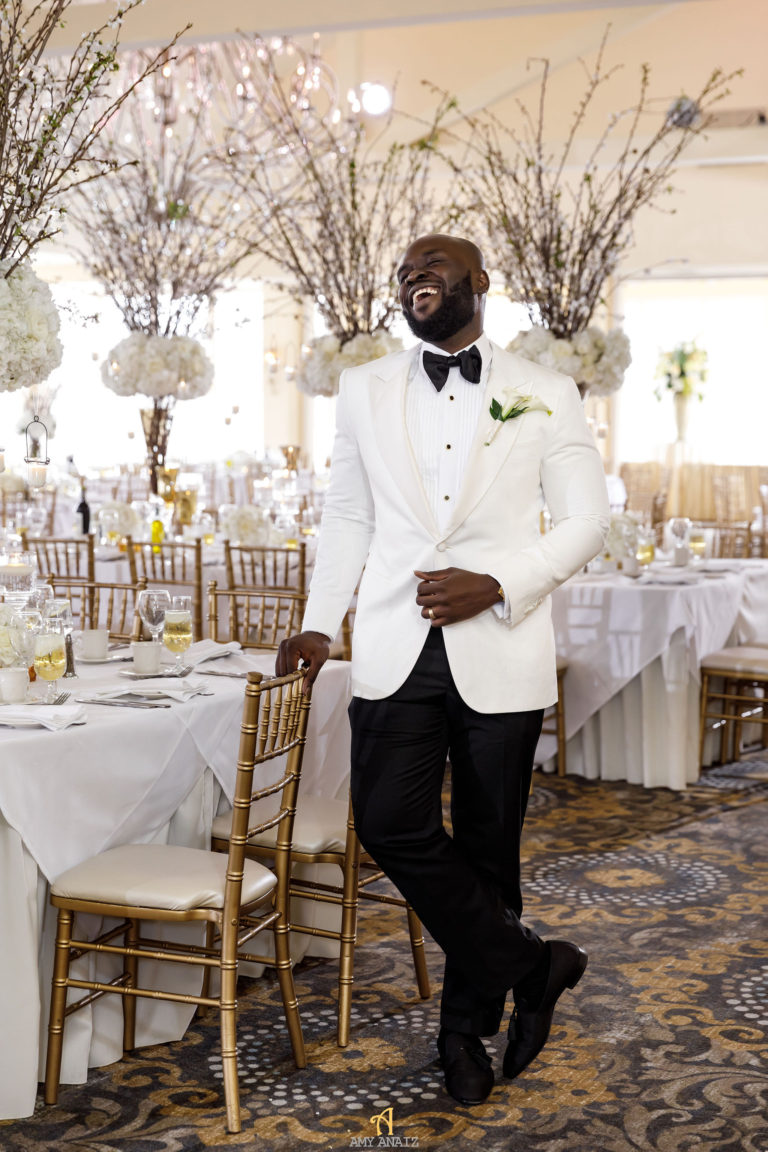 groom in white blazer statuesque events