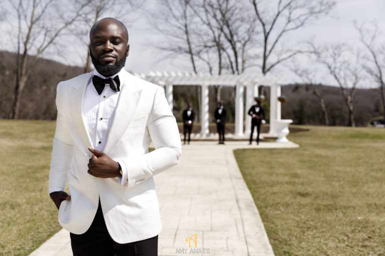 groom in white jacket statuesque events