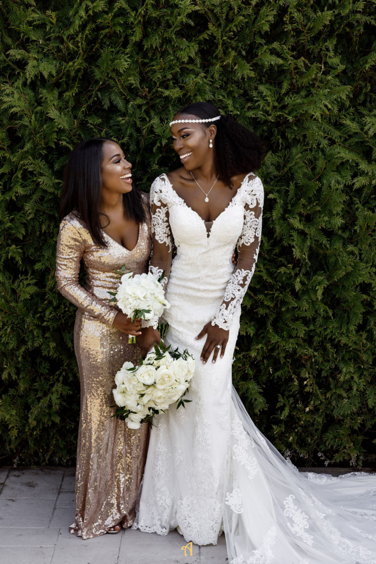 bride and bridesmaids love on wedding day statuesque events