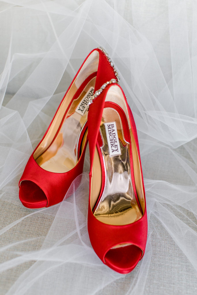 red and white wedding shoes statuesque events