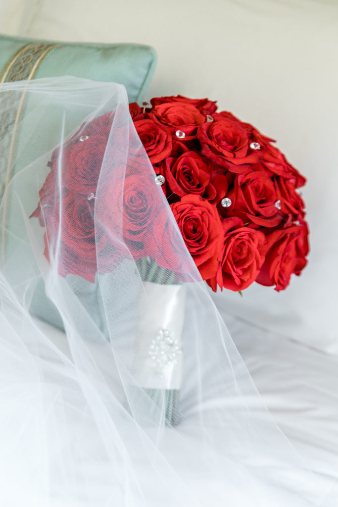 red wedding bouquet with bling statuesque events
