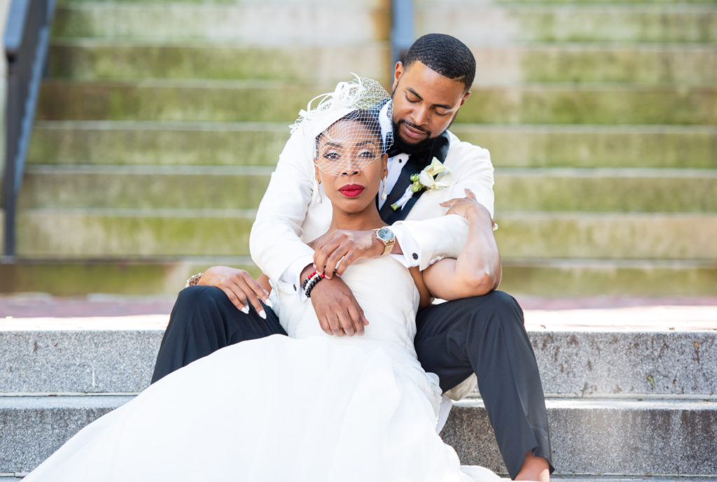bride and groom on courthouse steps maryland wedding planner statuesque events