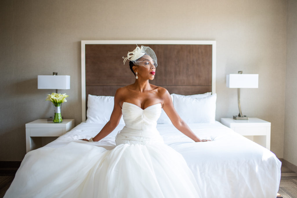 bride with birdcage maryland wedding planner statuesque events